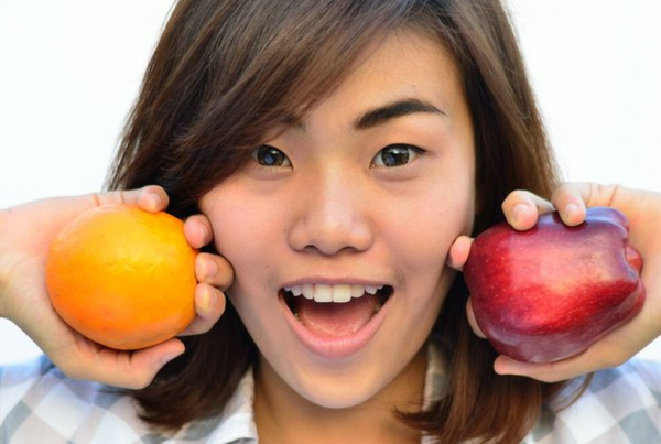 teenager with fruit
