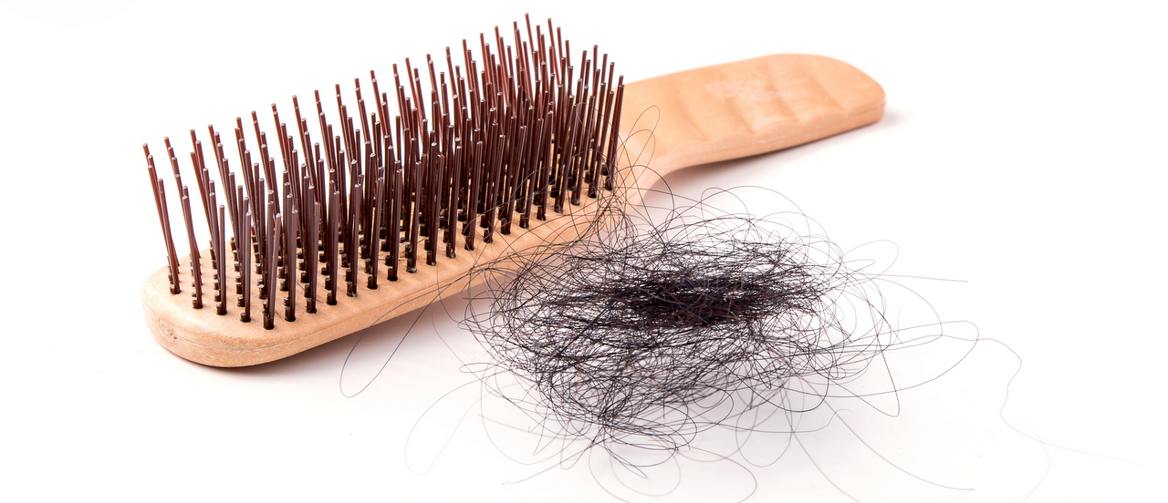 How much hair loss is normal in women?