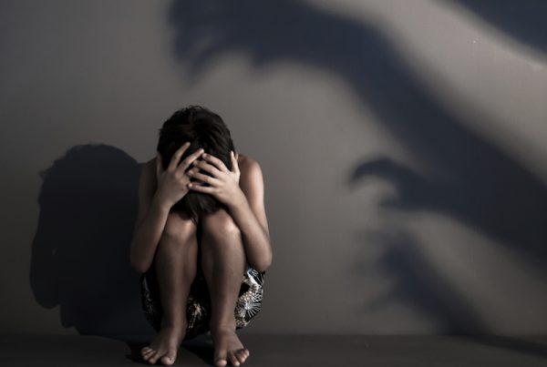 Fearful shadows scaring a child.
