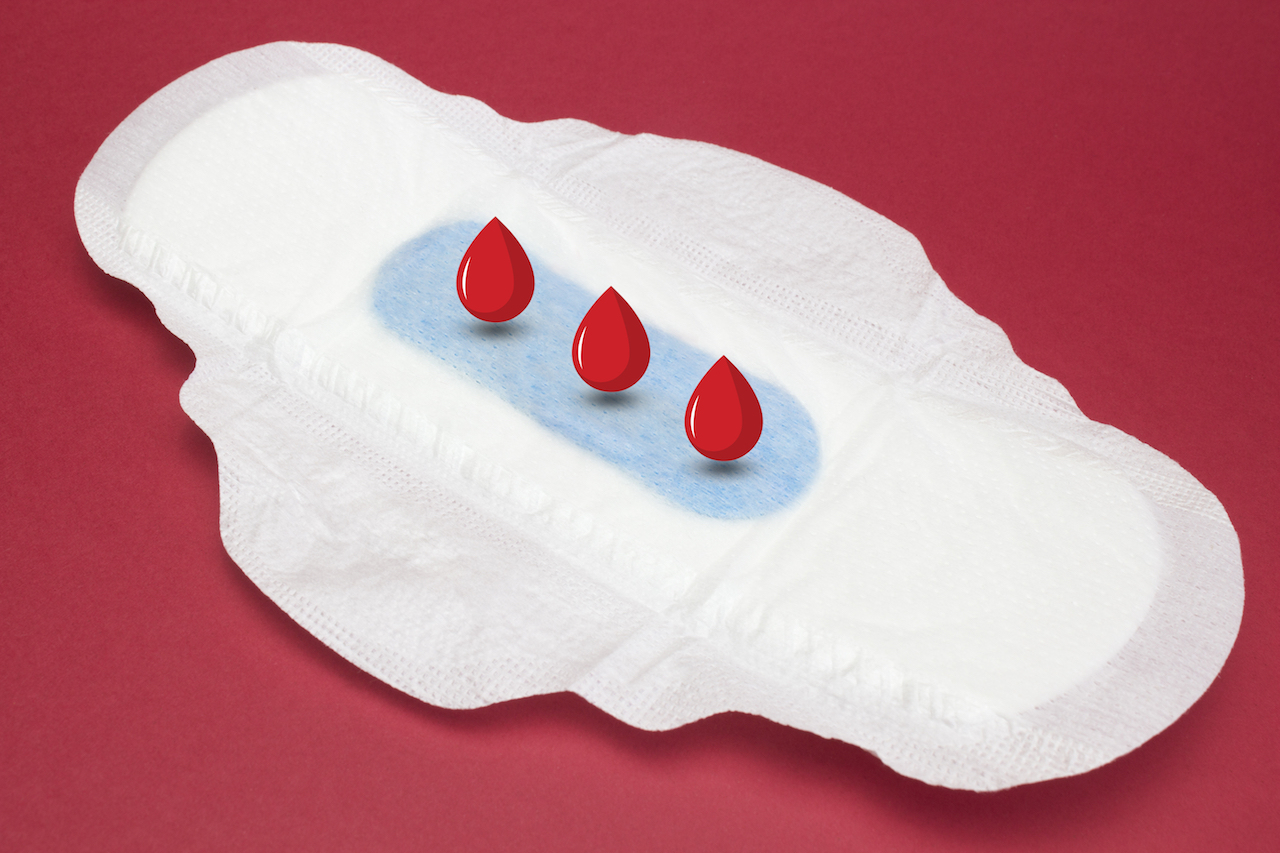 Why is my period blood dark?